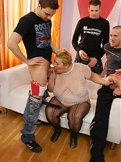 Kinky mature mama takes on seven guys
