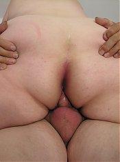 Big mama enjoying two old cocks