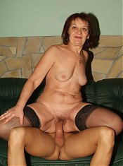 Stocking clad grandma Paula kneels down to give her hottie a blowjob and gets her old snatch fucked live