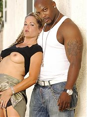 Curvaceous MILF Kelly Leigh spreads her stockinged legs to welcome a big black dick