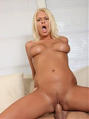 Blonde with big tits Riley Evans puts her top-heavy assets on display during a live sex show