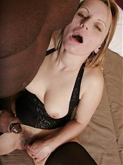 Pretty older gal Magda joins a black guy in bed and gets her pussy blacked on webcam